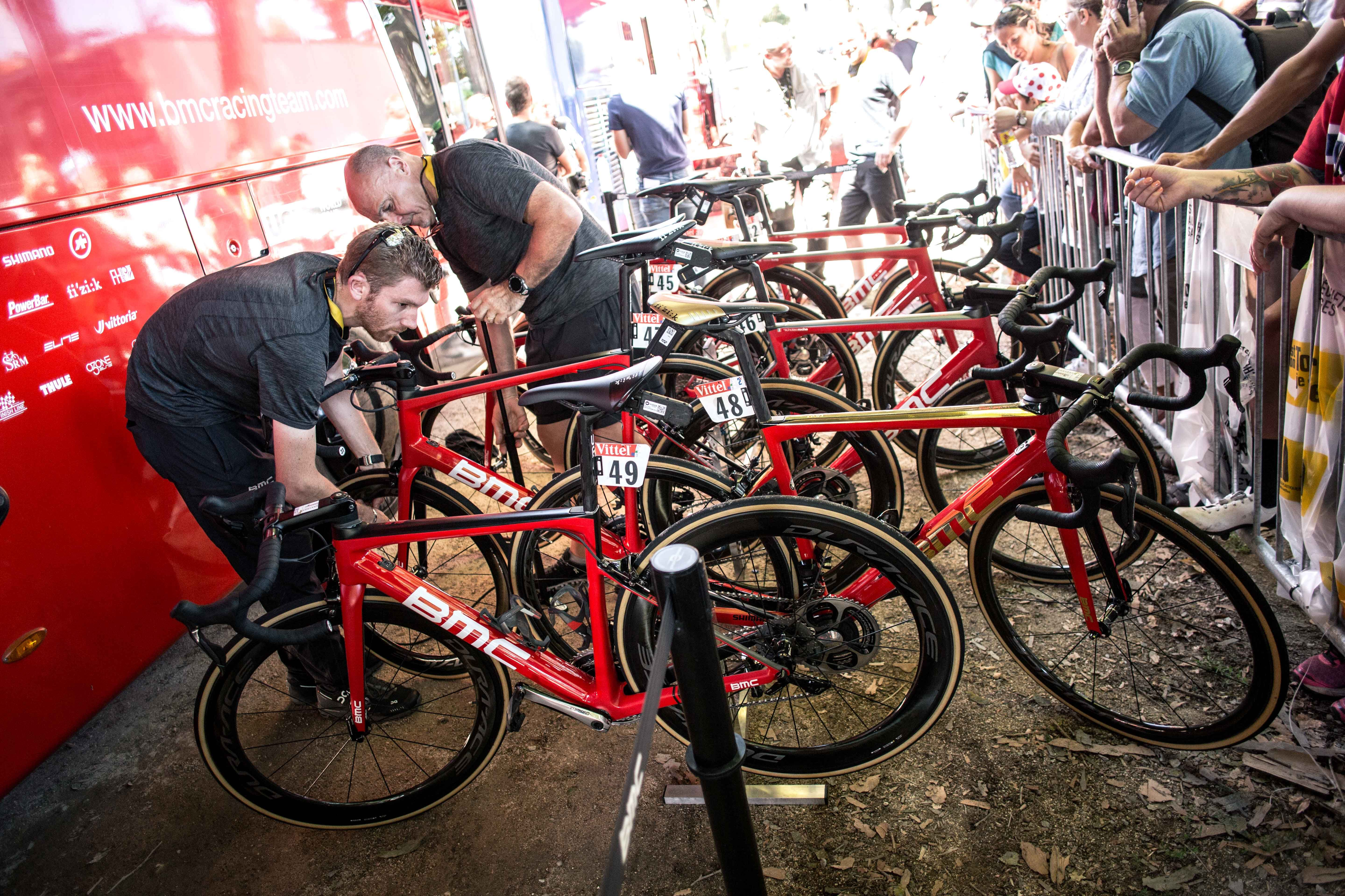 Inside The Tour De France Village Bmc Racing Team Mechanics Touch Up Riders Bikes For Today S Stage Tour De France Cycling Trips Thomson Bike
