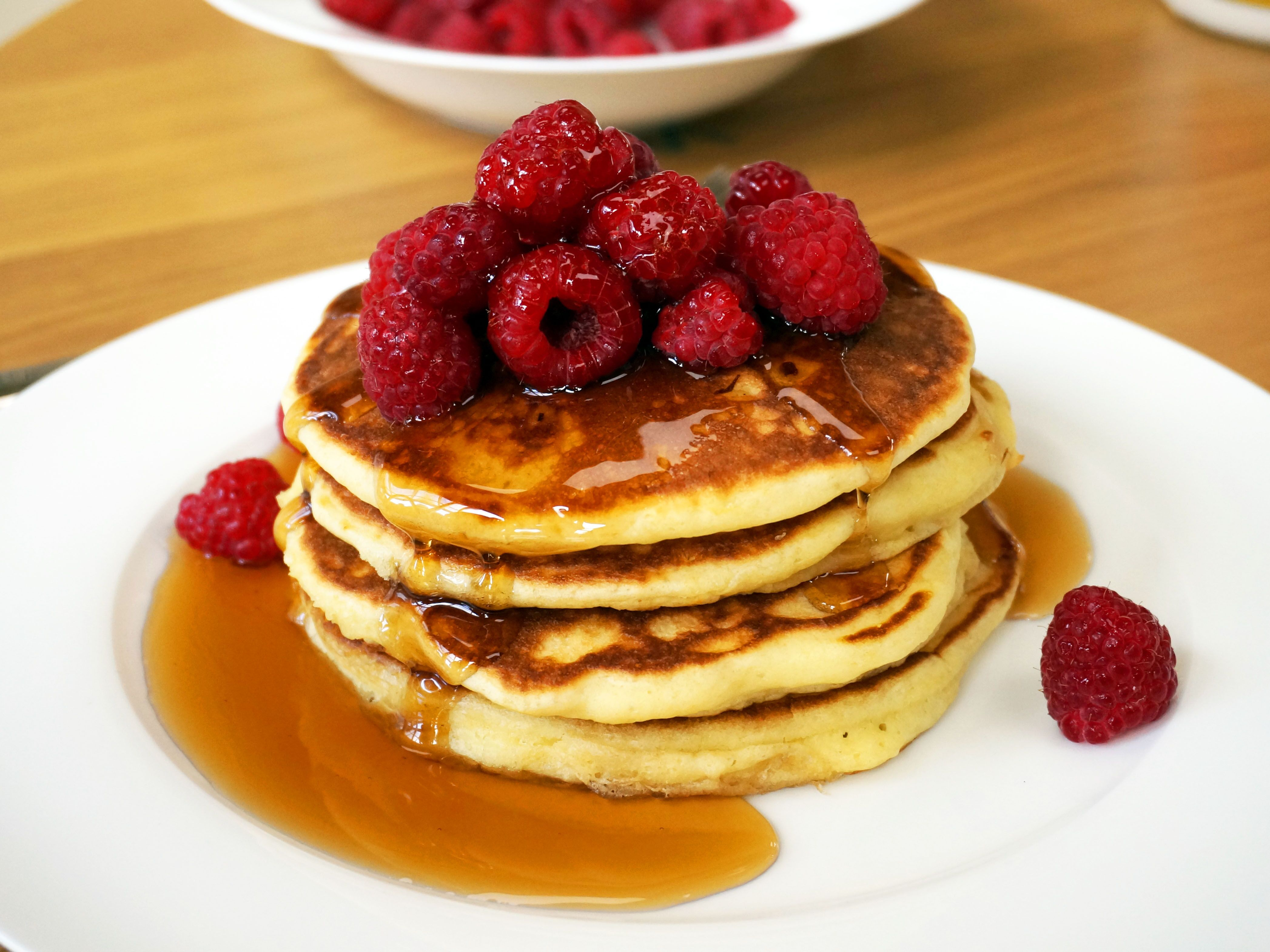 Buttermilk pancakes with fresh raspberries & maple syrup ...