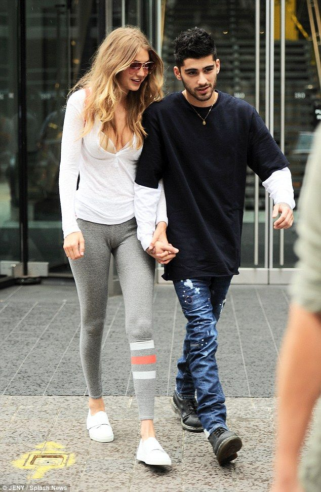 51c69449a4 So in love! Gigi Hadid and Zayn Malik could not have looked more besotted  as they stepped out for a walk in New York City on Wednesday