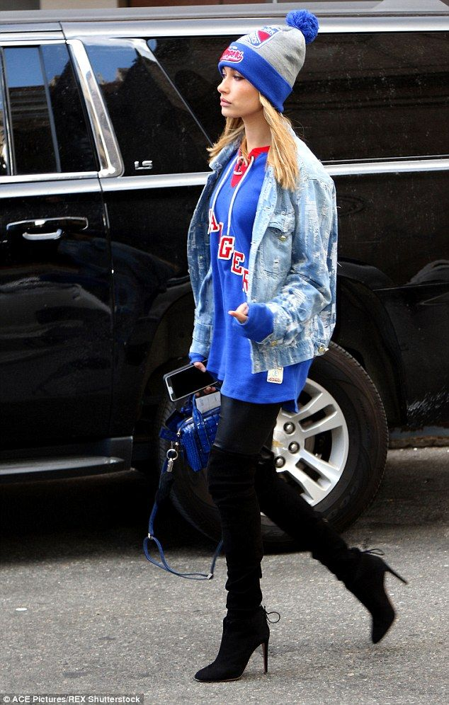 Hailey Baldwin Shows Her Colors In Ny Rangers Gear At Hockey Game Gameday Outfit Football Game Attire Shredded Denim Jacket