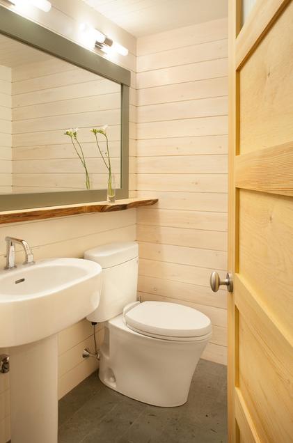A Toilet Can Help A Small Bathroom Appear Bigger Yep Learn How Designed Bathroom Wood Shelves Traditional Bathroom Windowless Bathroom