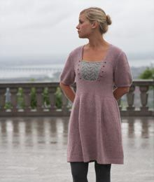 Construction Notes: This dress begins with the midriff band. Stitches are picked up along the band for the back and fronts, which are worked separately to the shoulders. The skirt is picked up at the other side of the band and worked in the round to the lower edge. The midriff band, lower edge and sleeve cuffs are worked in a slip-stitch pattern. The dress closes with a row of delicate buttons up the back, fastened with crocheted loops. A lace inset is sewn to the front of the dress and…
