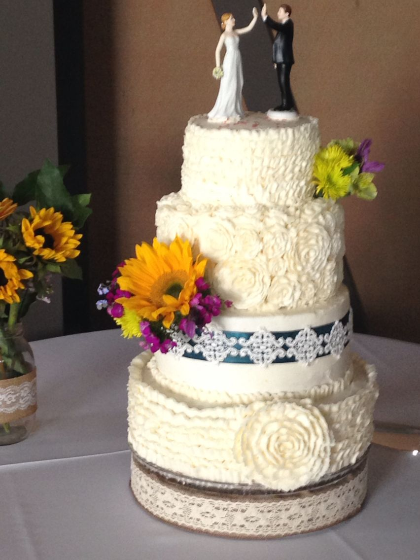 Liz's wedding cake with buttercream frosting. First tier ...