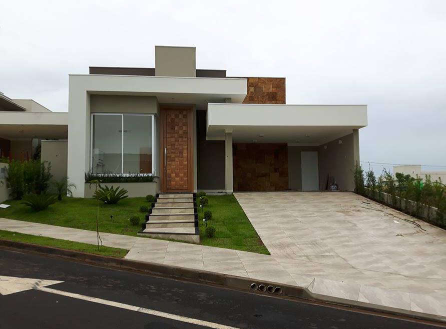 Casa de un solo piso presentamos una fachada que combina for Estilos de casas contemporaneas