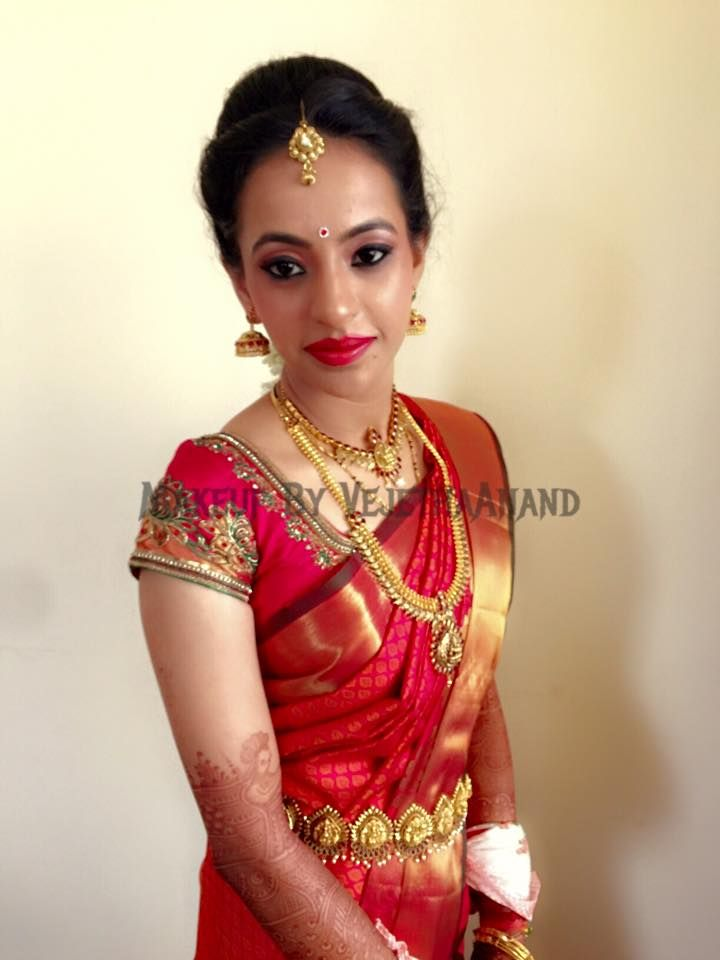 Traditional, Southern Indian bride, Priyanka wears bridal silk saree and jewellery for her Muhurat. Makeup and hairstyle by Vejetha for Swank Studio. #BridalSareeBlouse #SariBlouseDesign #redlips  Kanchipuram red and gold silk sari. Tamil bride. Telugu bride. Kannada bride. Hindu bride. Malayalee bride  Find us at https://www.facebook.com/SwankStudioBangalore