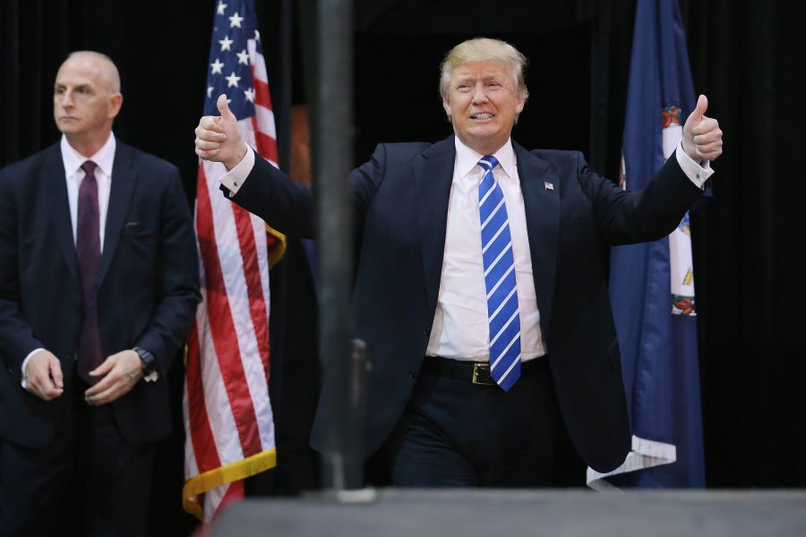 RICHMOND, VA - OCTOBER 14: Republican presidential candidate and front-runner Donald Trump arrives at a campaign rally at the Richmond International Raceway October 14, 2015 in Richmond, Virginia. A New York real estate mogul and reality television star, Trump is now in a statistical tie with retired neurosurgeon Ben Carson in a Fox News survey of likely Republican voters released Tuesday. (Photo by Chip Somodevilla/Getty Images)                                     via @A...