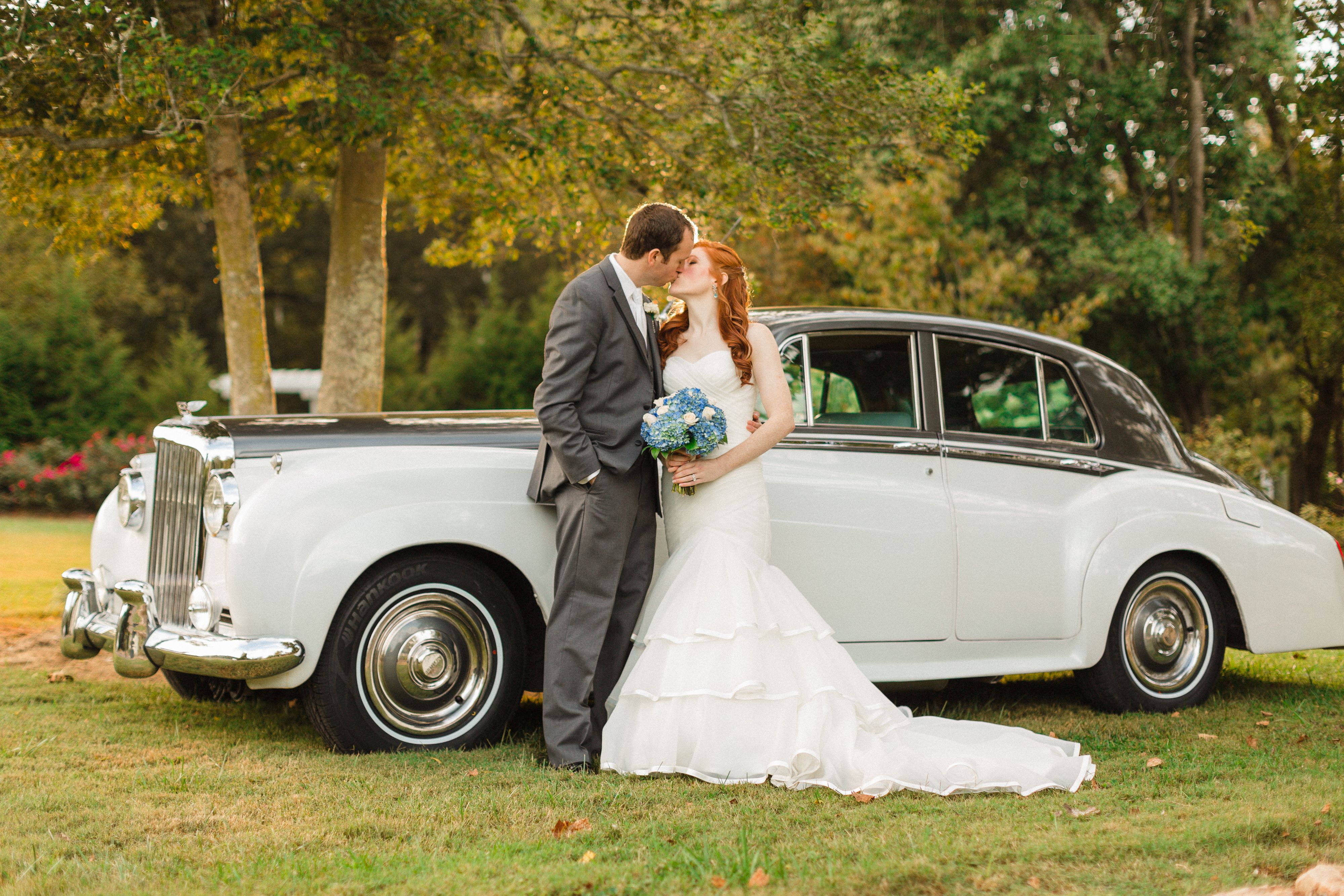 October wedding with a classic car provided by Regal Carriage in Knoxville, TN.