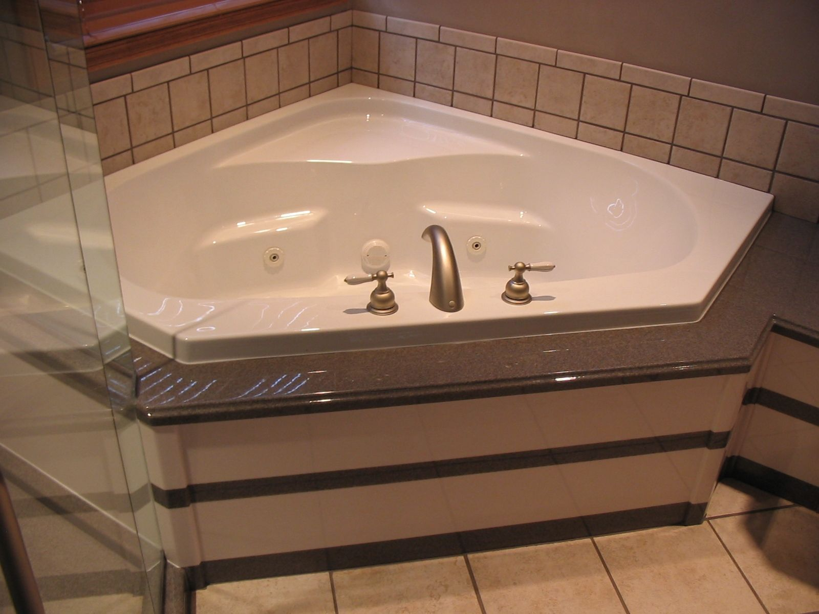 The Onxy Collection also offers customizeable tub surround options ...