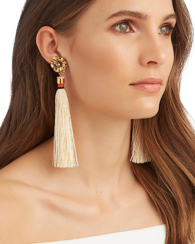 Lizzie Fortunato Tahitian Tassel Fringe Earrings: Exotic tassel fringe decorates these earrings calling for a swept up hair look. Post back for pierced ears. 5 1/2 long. In cream. Made in ...