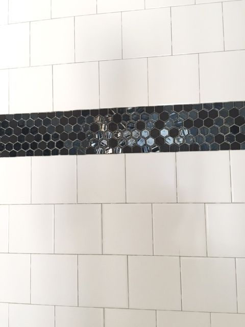 6x6 offset white wall tile with black hexagon accent tile for 6x6 bathroom layout