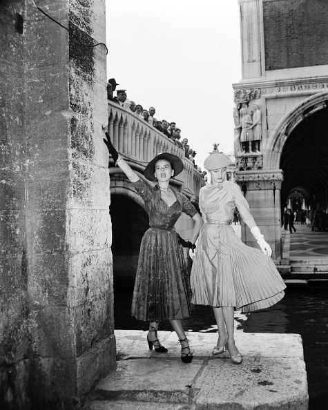 1951 - Christian Dior models in Venice - Sylvie Hirsch and Franceare watched by people on the bridge as they model Christian Dior's day dresses, Venice, June 1951 with <3 from JDzigner www.jdzigner.com with <3 from JDzigner www.jdzigner.com