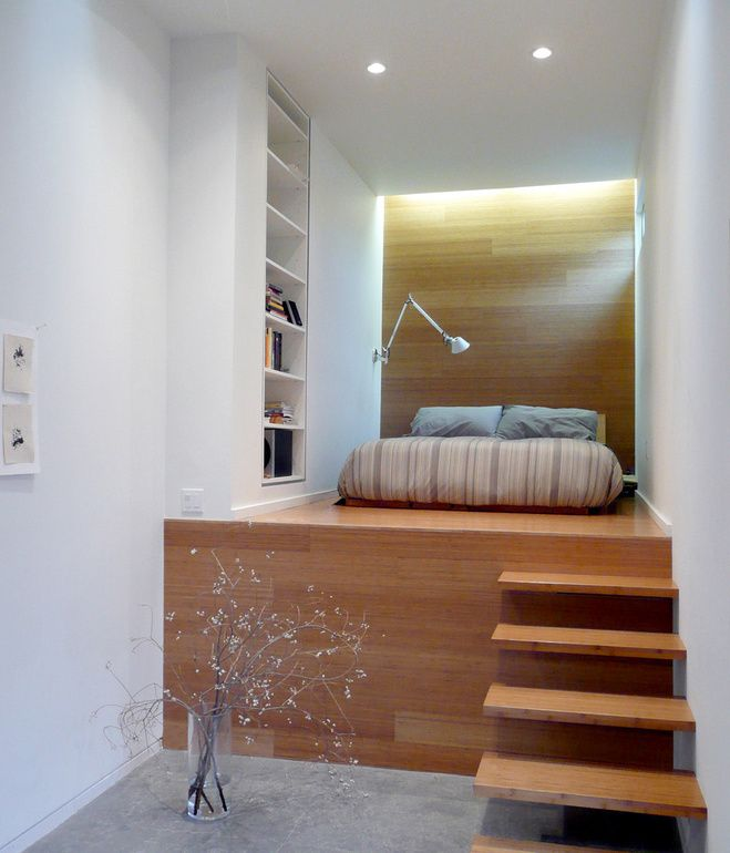The Master Bedroom Occupies A Long Slender Space On Two Levels