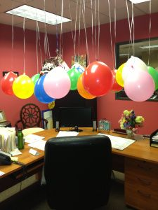 Office Birthday Decor, string up colorful balloons from the ceiling, before your Co-Worker comes in.