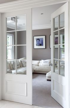 a pocket door like this and put photographs over glass panes for now when it's a bedroom then remove later.