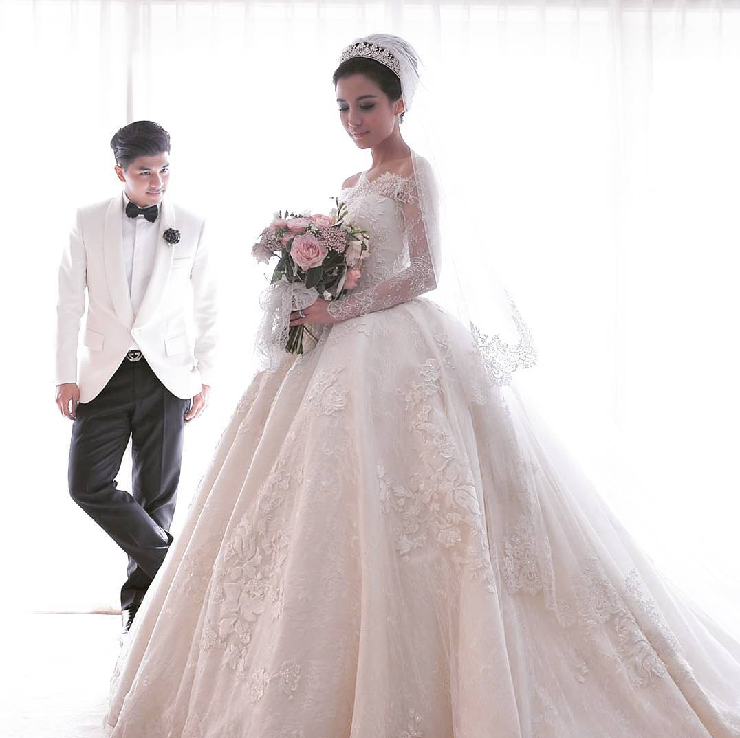 Elegant bride in bespoke Hian Tjen ball gown and tiara // Glenn