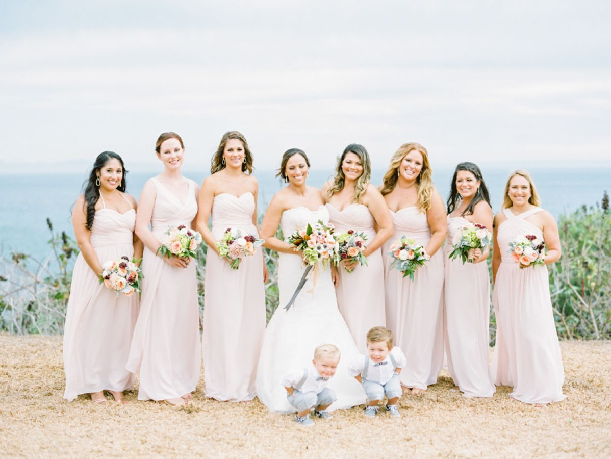 The bridal party + the cutest little dudes: http://www.stylemepretty.com/california-weddings/goleta/2016/06/29/a-santa-barbara-wedding-that-epitomizes-california-cool/ | Photography: Michael + Anna Costa Photography - http://www.michaelandannacosta.com/