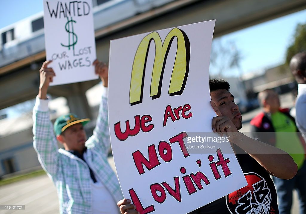 Fast Food Workers And Activists Protest Outside Of A Mcdonald S Fast Food Workers Food Service Industry Mcdonald S Restaurant
