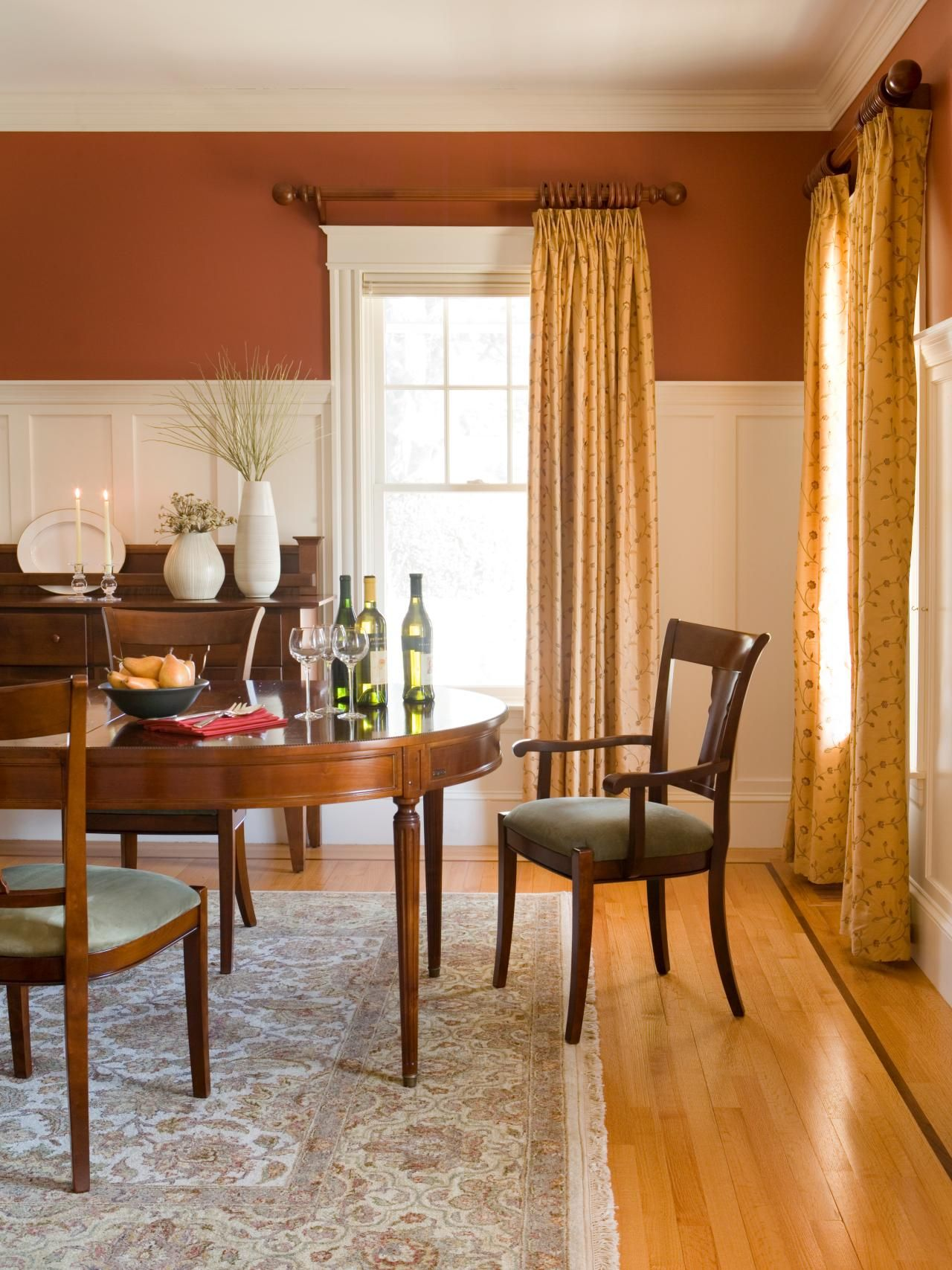 This traditional style dining room features white - Burnt orange feature wall living room ...