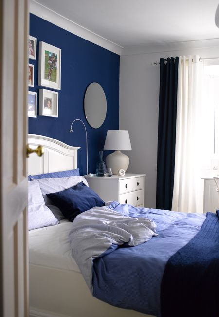 marvellous dark blue bedroom | Lamps plus bright reading lighting -- nice solution for ...