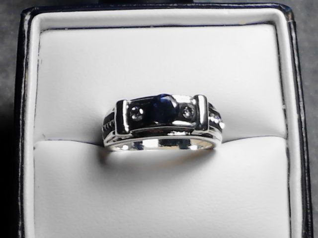 Sapphire Gem stand alone with two CZ side stones. set in Black Epoxy clay.  in Fine Silver Band. accented with small CZ gemstones on each side. size 7 a74859a4cdb9