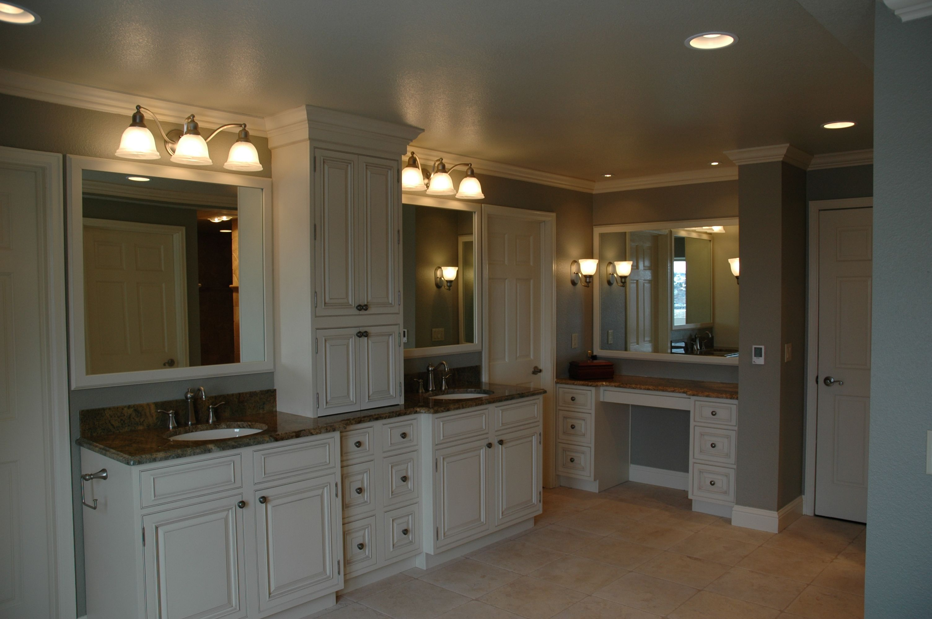 Luxurious double vanity with center tower and a makeup