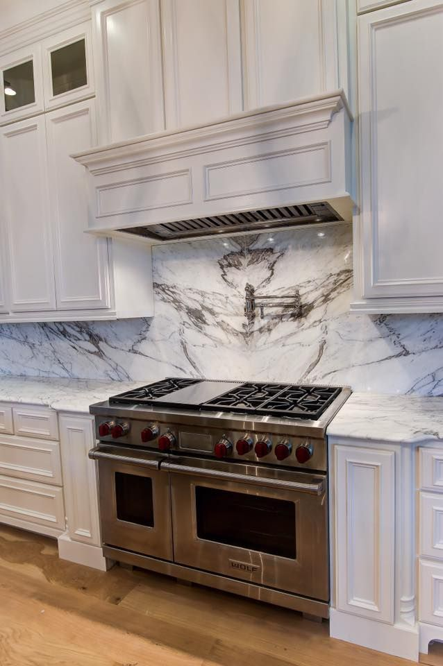 Calacatta Venato Marble Counter With Bookmatched Backsplash