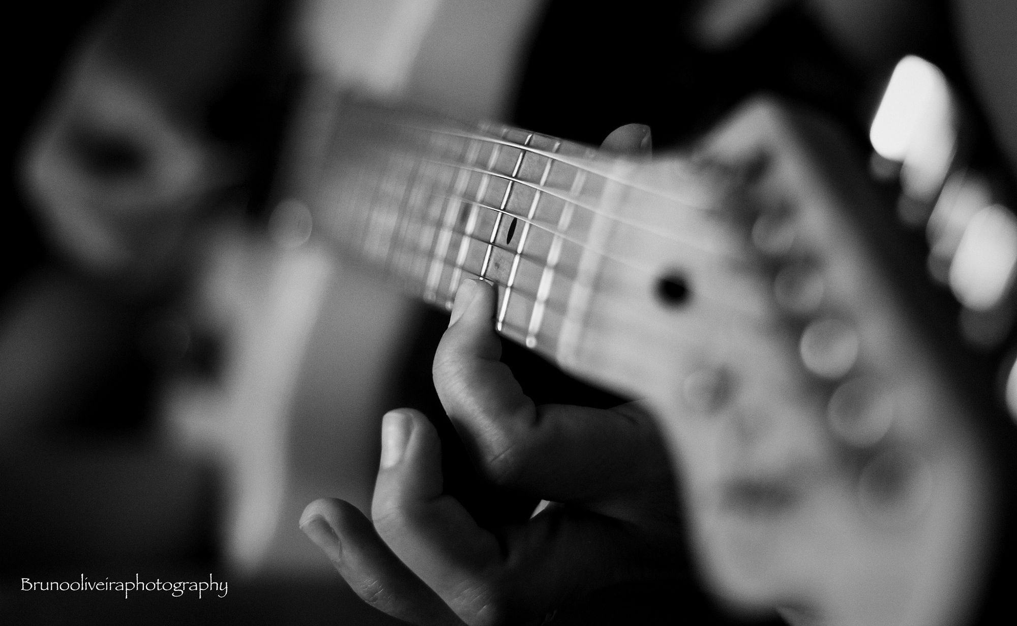 Playing a guitar by Bruno Oliveira (@brunooliveiraphotography) - Photo 183426643 / 500px.  #500px #blackandwhite #schwarzweiss #noiretblanc #siyahbeyaz #monochrome #studio #concert #music #guitar #instrument #band #musician #sound #bass #jazz #lenses #praia #acoustic #música #pessoas #férias #sensor #brasil #joãopessoa #augsburg #ulm #münchen #stuttgart #frankfurt