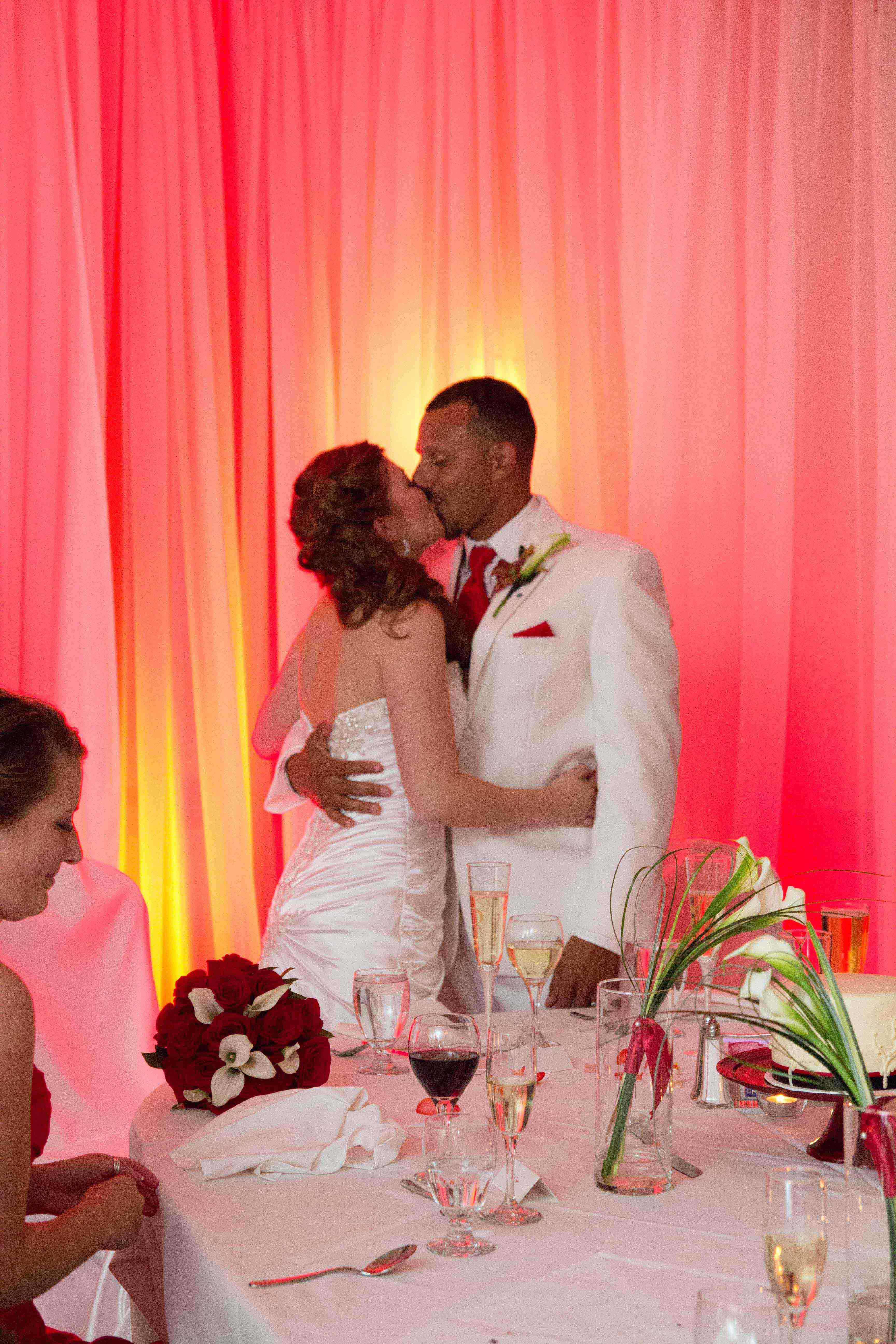Wedding event background  Itus as if their love is setting the room on fire Photo by Heidi S