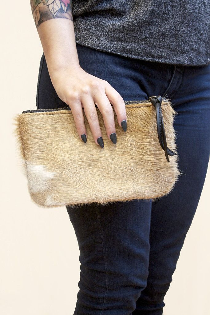 Tired of carrying a purse everywhere? Yeah, so are we! Try this cowhide clutch! You won't regret it.