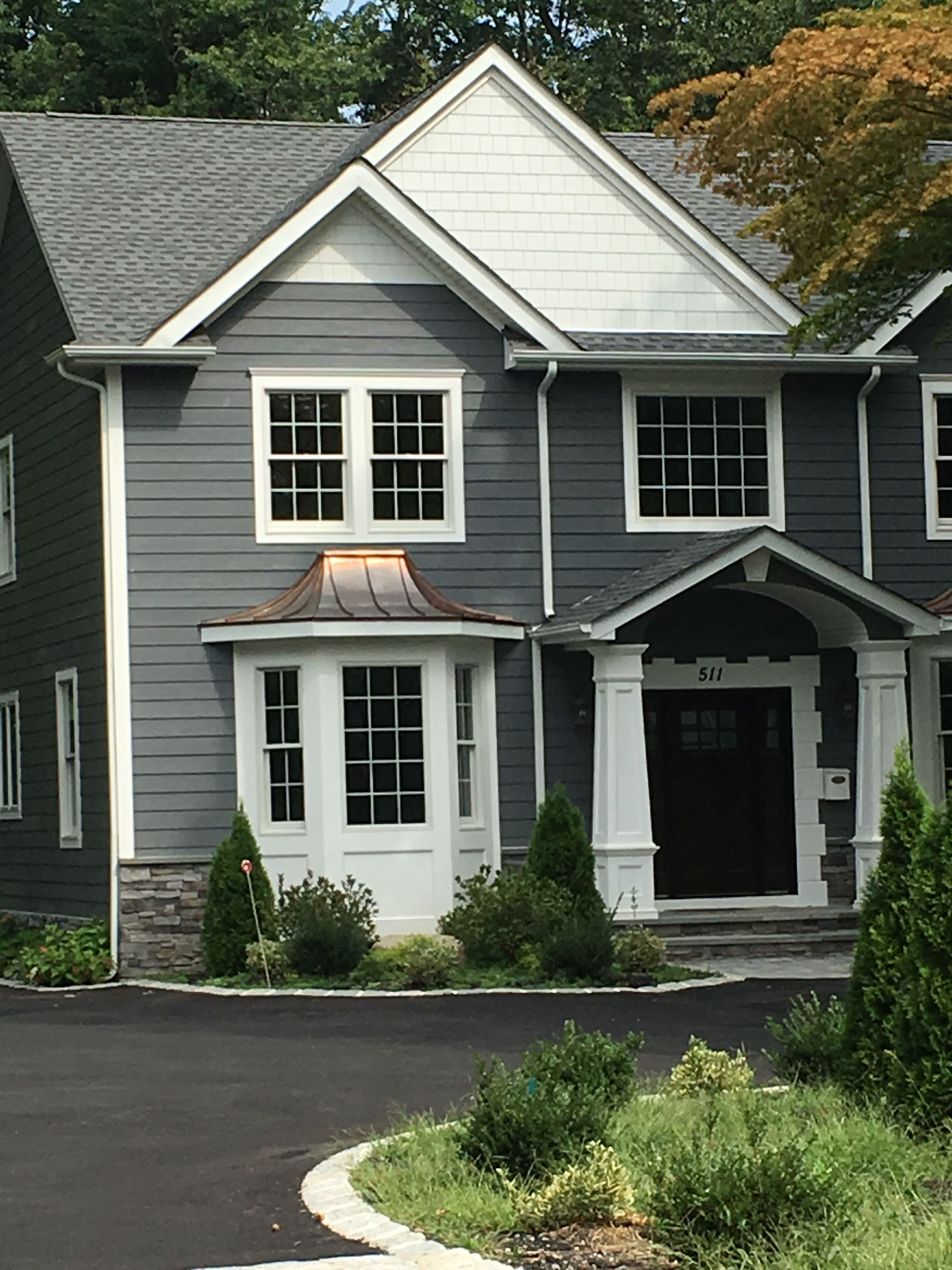This Color Contrast Gray And White Double Window Above The Bay Is Well Proportioned Outdoor Decor Contrasting Colors