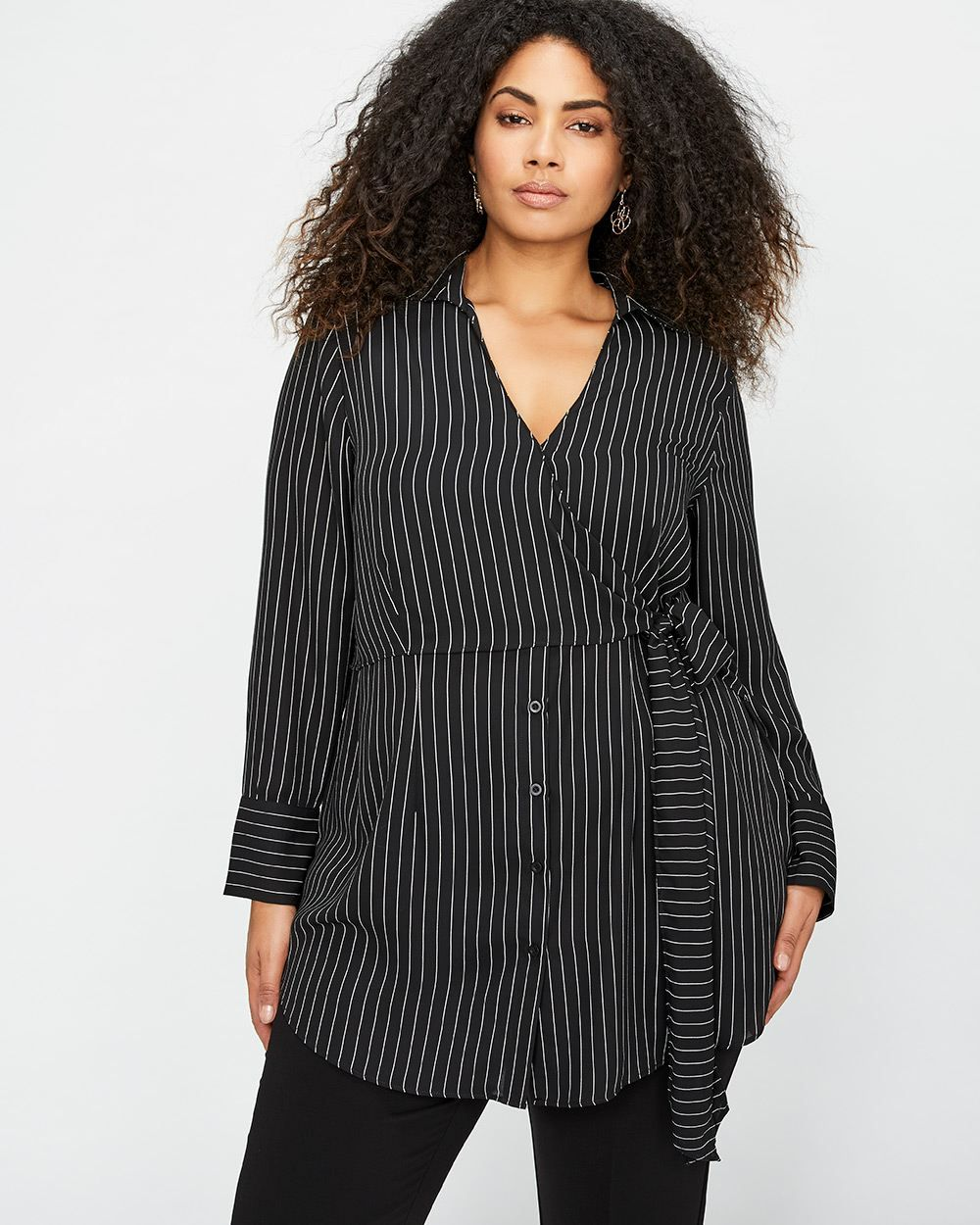 566ed583b6f Opt for a refined look with this plus size striped wrap tunic by Michel  Studio. Wear it with black leggings and heels for a feminine look.