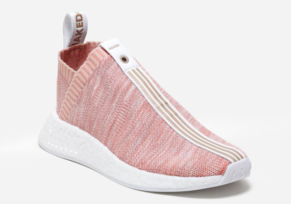 d424259fa9f1 New images of the Kith x Naked x adidas NMD City Sock 2 in the pink  colorway.