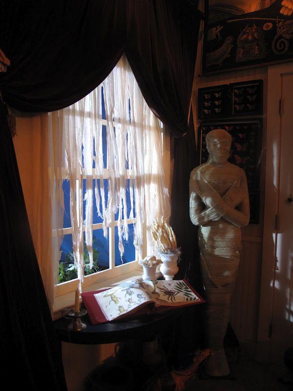 Shredded curtains helped to provide an eerie lightgreat mummy - halloween garage ideas