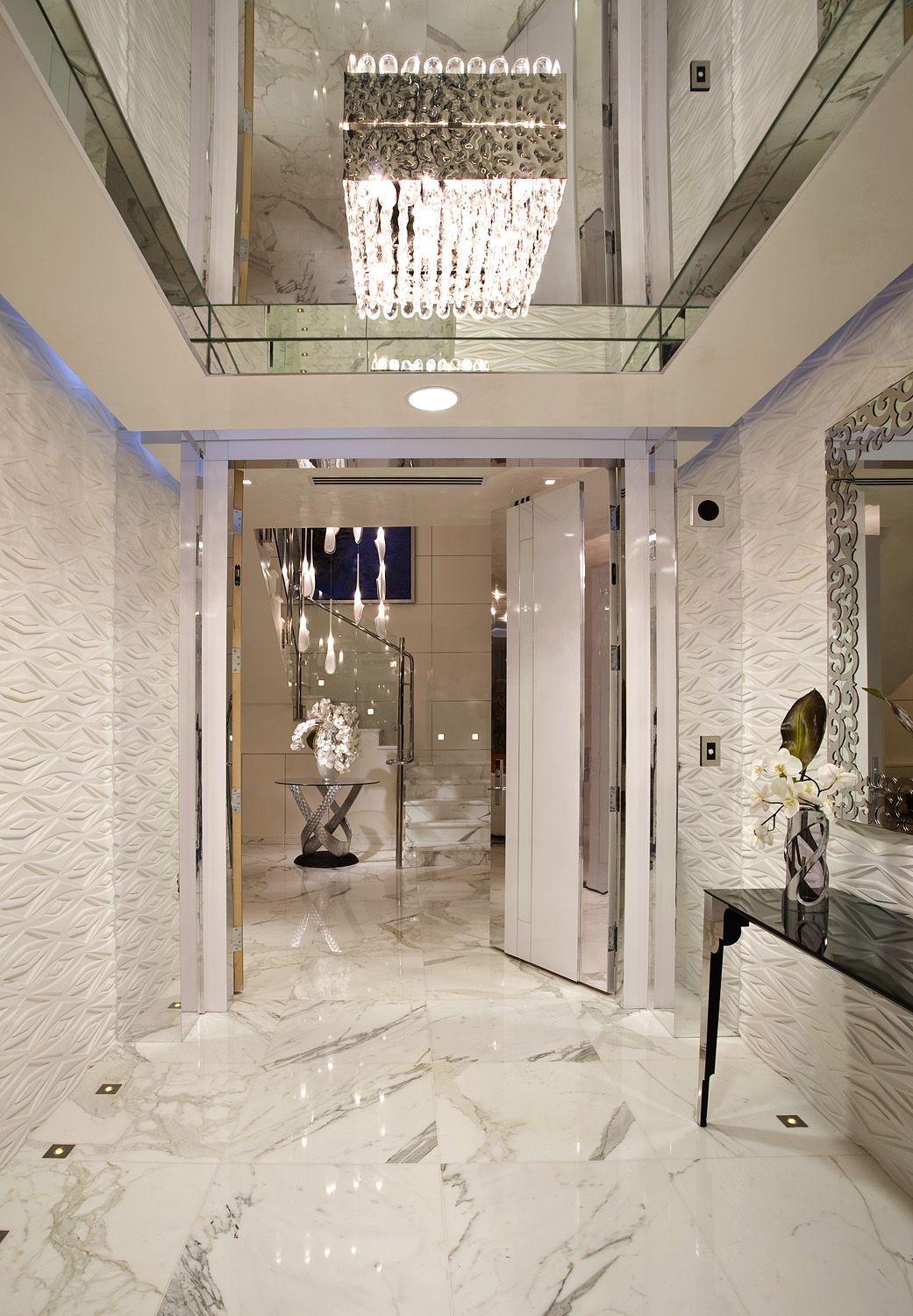 Now this is a luxurious modern marble entry idea! i believe this ...