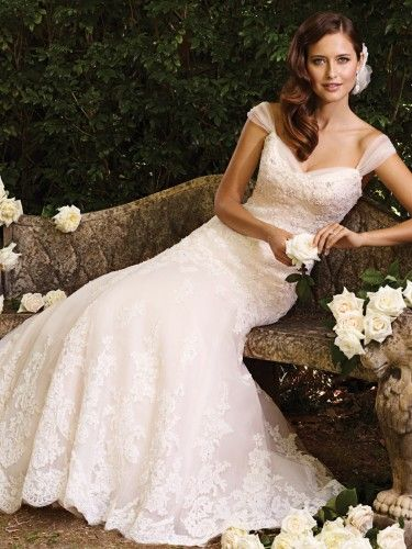 """Sophia Tolli's 2013 fall gowns are """"both classic and couture designs"""" such as A-line dresses, halters and slim skirts as well as strapless ball gowns."""