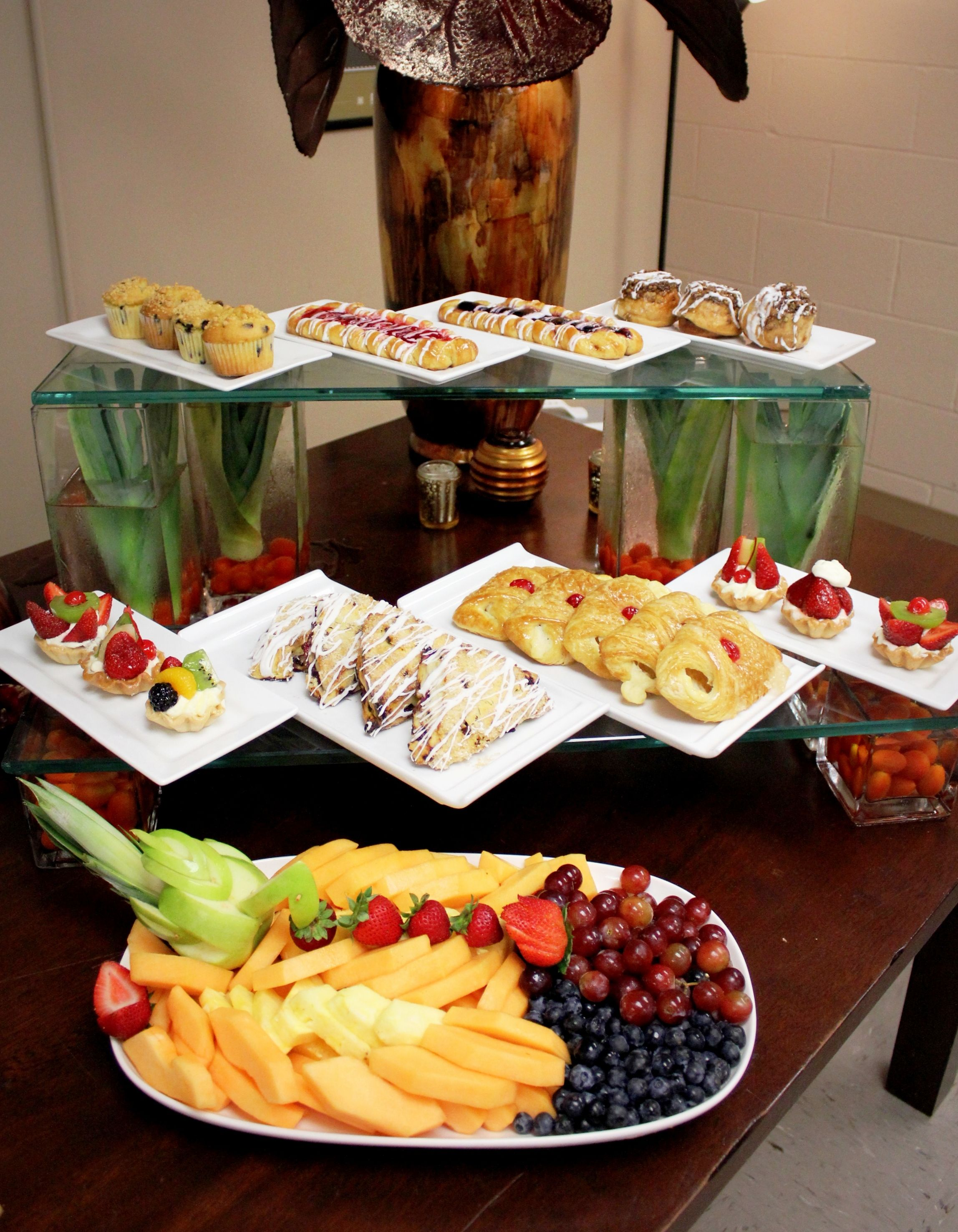 Continental Breakfast Display Muffins Danish Caramel Roll Fruit Tart Scones Cheese Croissant Breakfast Buffet Breakfast Catering Breakfast Buffet Table