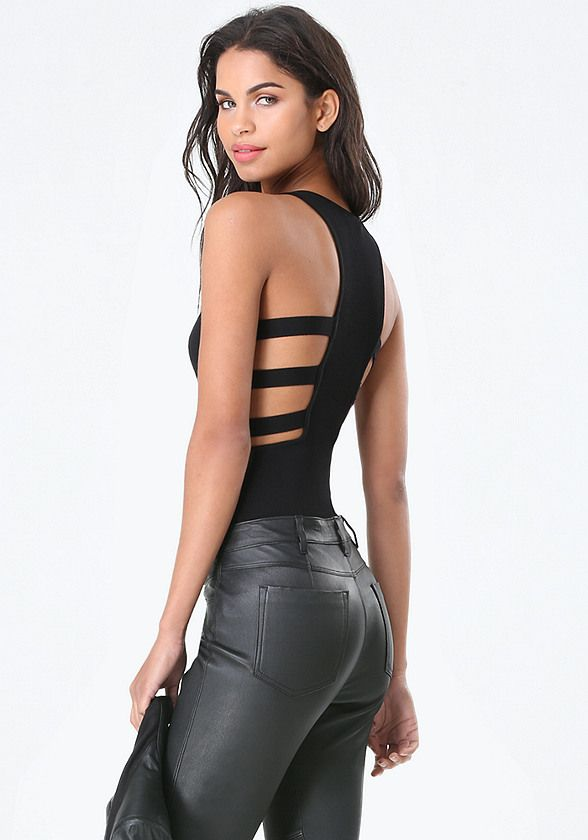 Rule-the-scene knit bodysuit with strappy side detailing that reveals skin and curves. Snap panty closure.