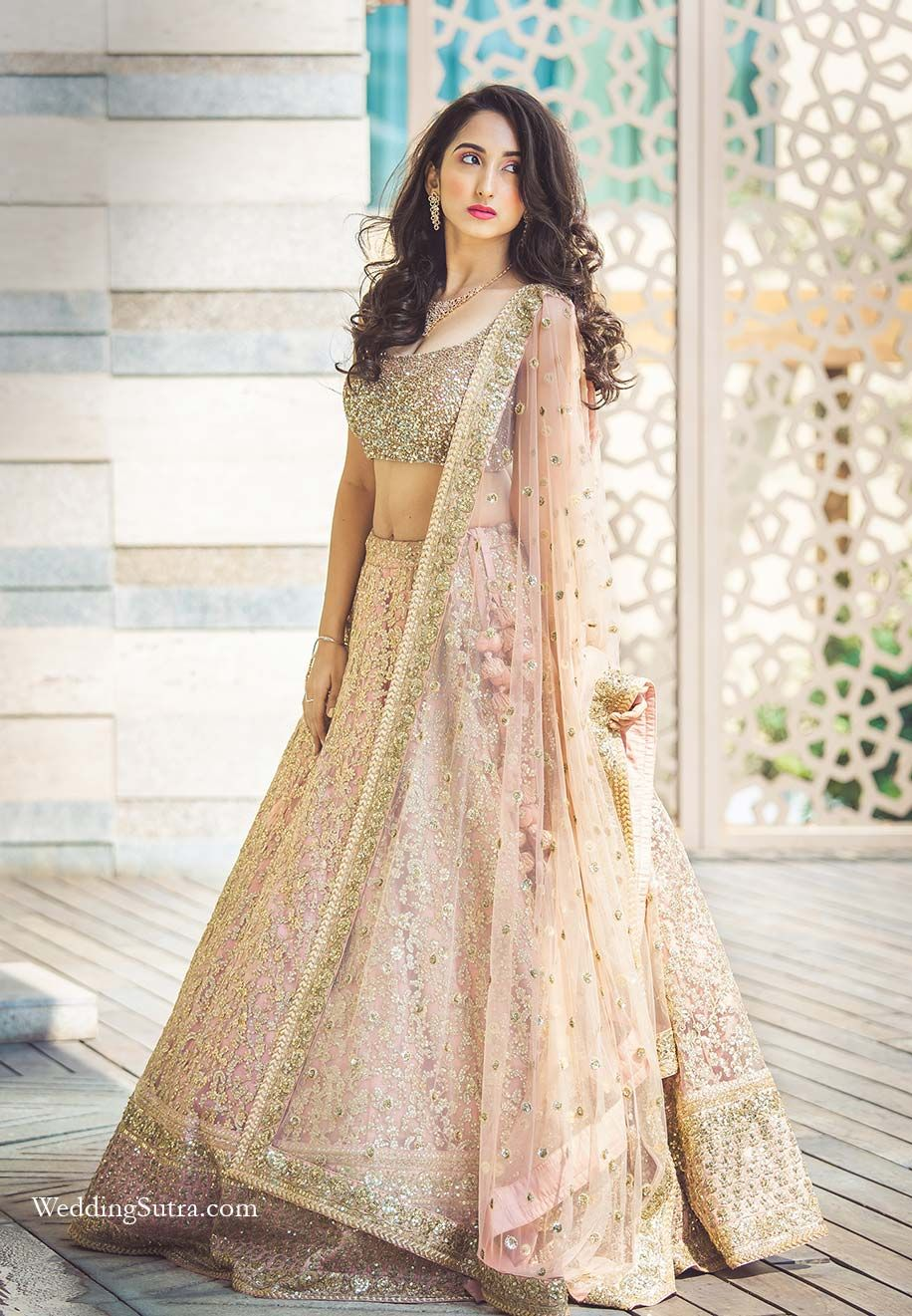 1bc1b40ed3 A beautiful Pink Lehenga completely covered with sequence by Sabyasachi at  WeddingSutra on Location. #