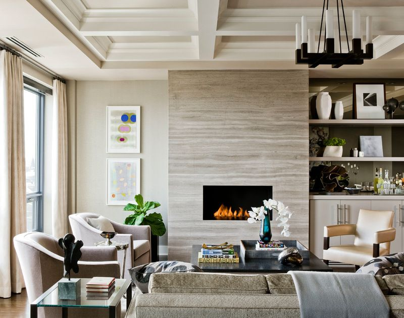 stone slab fireplace cladding and built-ins to one side; coffered