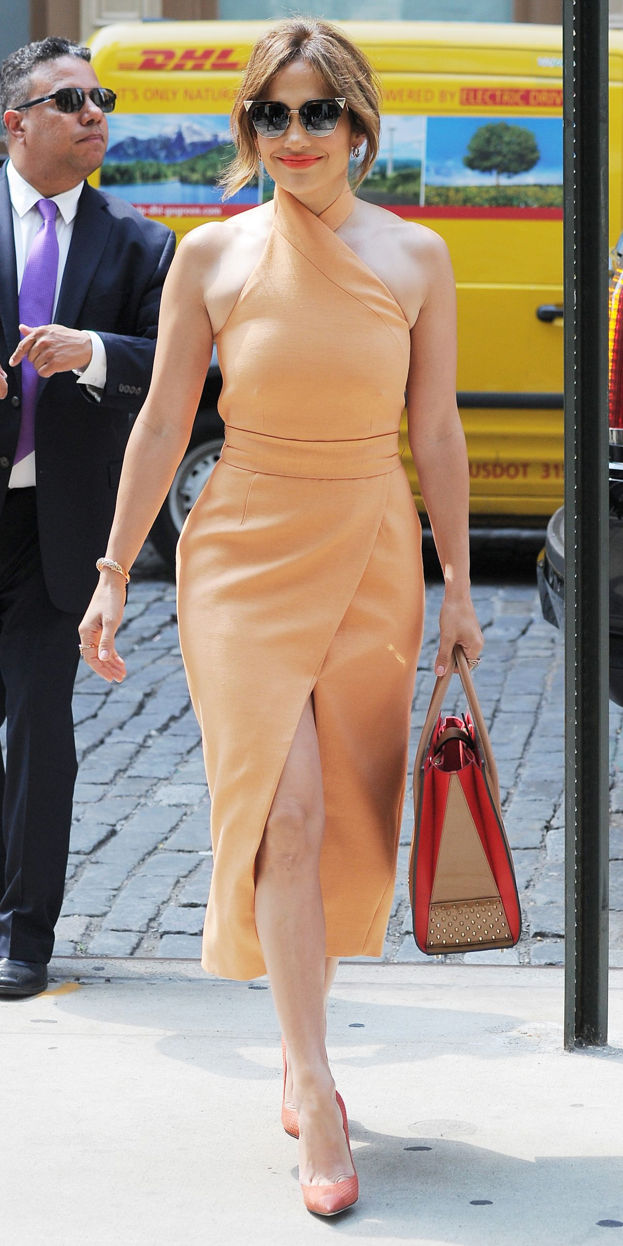 aaae4f62e245 Jennifer Lopez in a peach criss-cross number