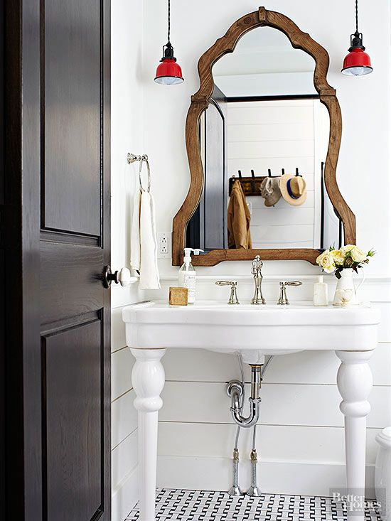 White Walls With Shiplap Wainscoting Let Red Farmhouse Pendants, A  Curvaceous Mirror, And A Stately Pedestal Sink Advance Into View.