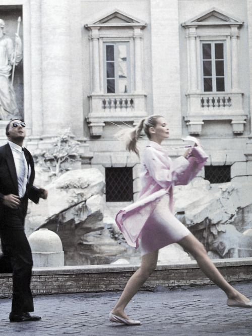 Claudia Schiffer skips along in 'Roman Holiday' shot by Arthur Elgort for Vogue US December 1994