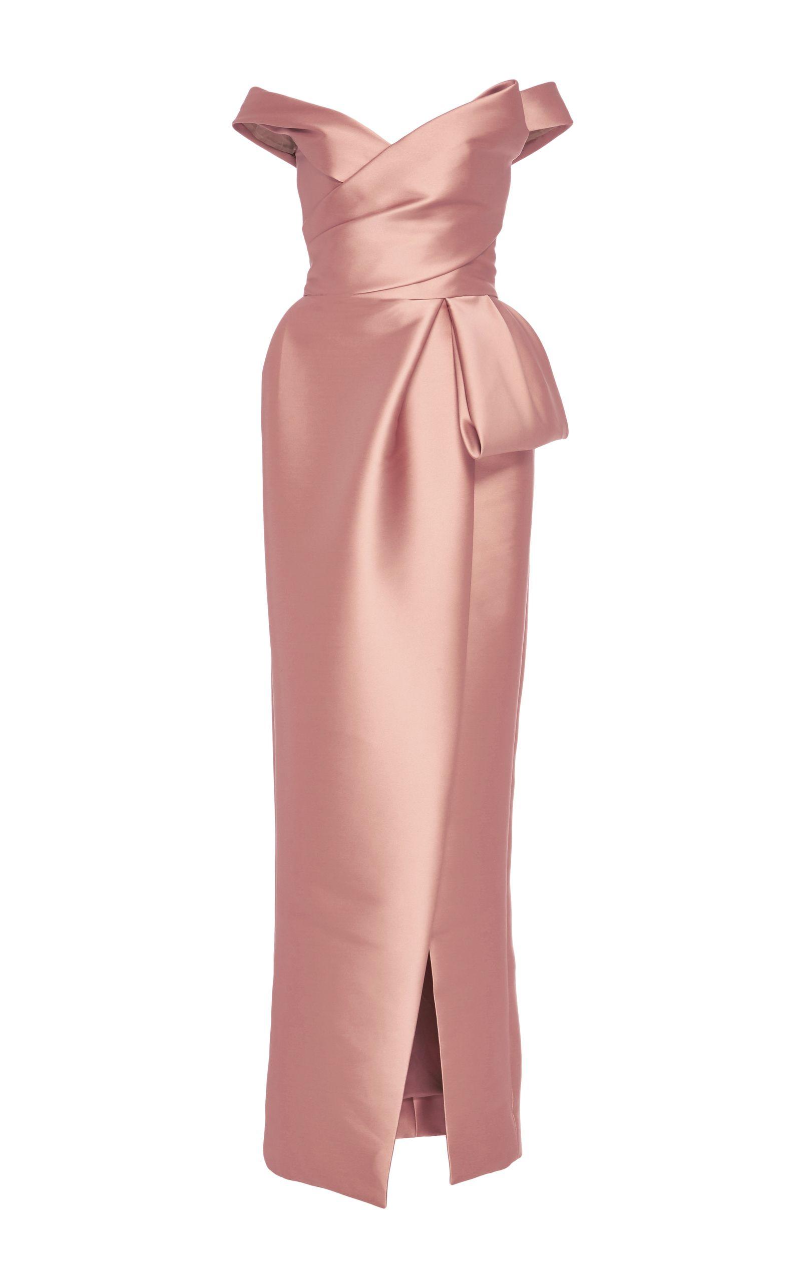 This Monique Lhuillier gown features an off the shoulder neckline, a ...