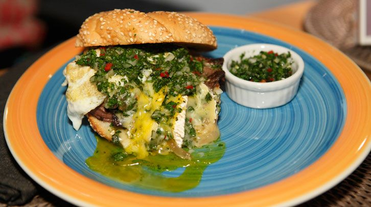 Chef Anne Burrell's Steak Sandwich with Onions, Camembert, Fried Egg, and Chimichurri #recipe