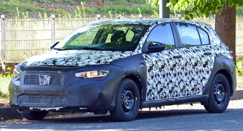 2021 Fiat Tipo Facelift Might Get A Jacked Up Cross Version Carscoops In 2020 Fiat Tipo Fiat Plastic Cladding
