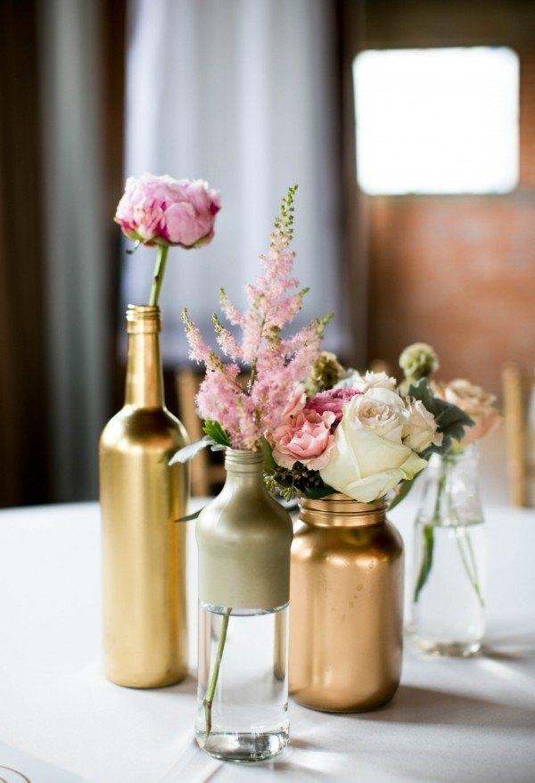 Spray painted bottles make beautiful centerpieces say i for Painted wine bottle wedding centerpieces
