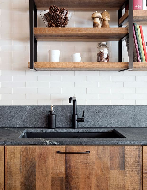 This contemporary kitchen features a countertop and curb backsplash made of honed Alberene soapstone, a pleasantly textured variety with a soft grey hue.