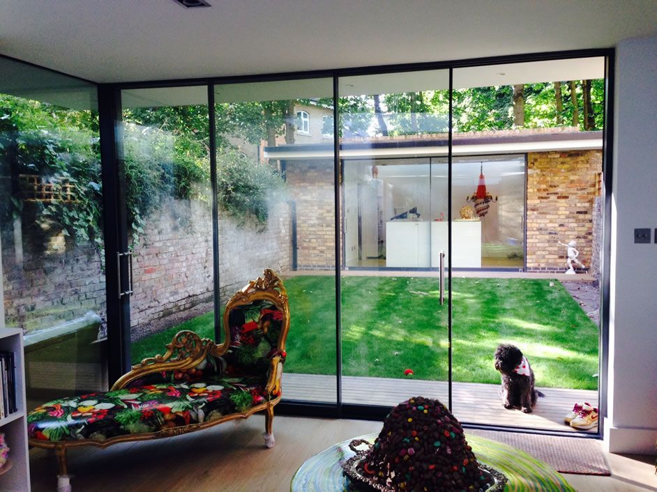 Frameless sliding patio door system slimline glazing for Double sliding patio doors