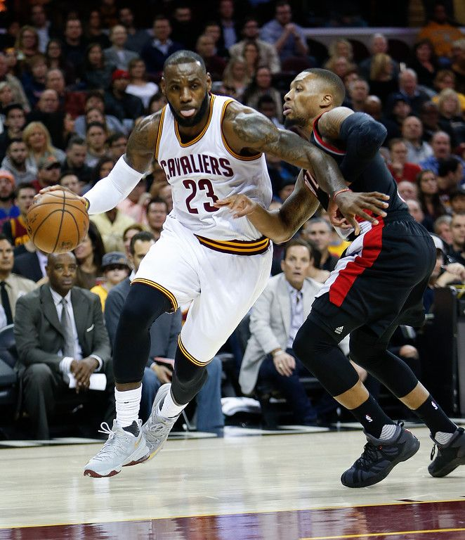 Cleveland Cavaliers Lebron James  Drives On Portland Trail Blazers Damian Lillard  During The First Half Of An Nba Basketball Game Wednesday