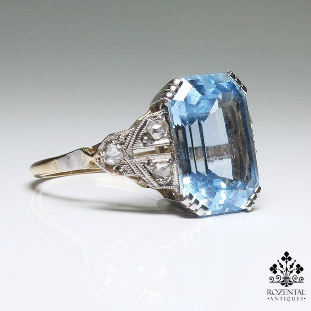Period: Art deco (1920-1935) Composition: 18K gold and platinum Stones: 6 Rose cut diamonds of J-SI1 quality that weigh 0.20ctw. 1 blue topaz that weigh 5ctw. a